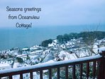 Enjoy a snowy view from inside a cosy & warm Oceanview Cottage.