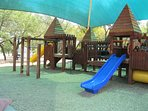 The Neighborhood Park Features This Covered Playscape Along With Sports Court, Swings, Soccer Field