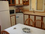 The kitchen with dishwasher, stove,oven, refrigerator etc...
