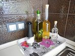 A complimentary bottle of wine, a bottle of raki and a bottle of olive oil are offered to guests