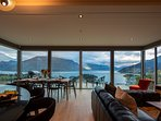 Floor to ceiling glass windows and sliding doors allows for maximum enjoyment of the stunning views