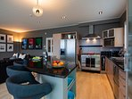 Fully-equipped kitchen with coffee machine, gas cooking and stainless steel appliances