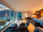 Spacious master suite with wall-to-wall views