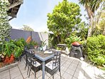 Courtyard with choice of flat bed gas BBQ or WeberQ grill. Private with tropical garden.