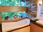 The Tree Top view bath is a guest favourite, and it's big enough for two!