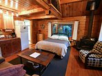 Our one room cabin has a queen bed on the main floor