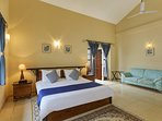 Master bedroom on the first floor is a large naturally lit room with private balcony over the garden
