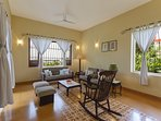 The main living room on ground floor overlooking back garden in this Holiday Home in South Goa