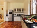 18.Open plan modern kitchen with freshly sourced local produce for the cook to prepare delicacies