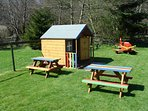 Yong children love their own play area with Wendy House, aeroplane, and child-sized picnic benches.