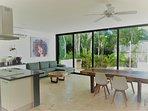 Stylish living/dining area facing the beautiful jungle.