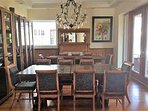 Dining room configured with tables apart.