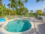 Heated pool with shallow end and fountain which children and sunbathers love