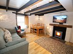 Lounge with view into the harbour and a log burner