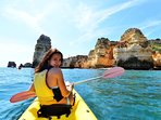 Do the caves by boat or by kayak, either solo or in organised groups