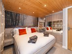 Master bedroom with luxury fitted furniture and king size luxury bed