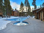 Outdoor heated pool and hot tubs at the Columbine Pool Complex