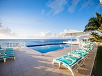 The many shades of blue and turquoise greet you from the pool deck up to the sky and across the sea
