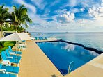 Gorgeous infinity pool hangs on the ocean! Long enough to swim laps with a shallow sunbathing deck.