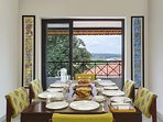 Dining area with balcony overlooking the backwaters of this Holiday Villa in North Goa