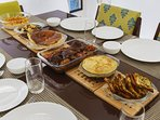 A delicious meal spread on the dining table, prepared by our in-house cook just for you!