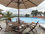View of the open-air pool overlooking the Charao island bird sanctuary across Mapusa river