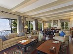 The expansive living area luxuriously furnished overlooking the valley and the gardens