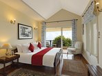 Third bedroom on the first floor with the common wraparound balcony in this vacation home in Kasauli