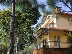 The plush holiday villa in Kasauli as seen from one of the gardens