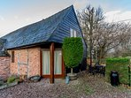 THE OLD DAIRY, pet friendly, character holiday cottage, with open fire, en-suite