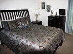 Bedroom 2 with en-suite, queen size bed and TV