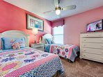 Kids bedroom with two twin beds and ideally decorated for girls