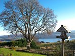 View from conservatory door of garden and Loch Ness.