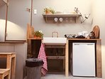 Kitchenette with cooker, toaster, coffee and tea.
