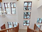 Beautiful staircase w/ lots of windows for natural light