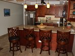 New stainless french door refrigerator and 4 swivel bar stools that replace dining table and chairs