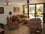 New living room furniture includes queen sofa/bed; 2 recliners; ottoman.  Kept a bit of Hawaiiana!