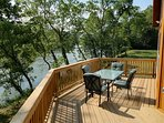 Large deck with sitting room for 8+ directly overlooking the river!