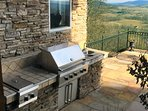 Gas grill outside with large open area around it