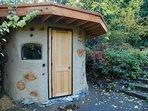 enjoy this beautiful wood heated cob sauna with cedar benches