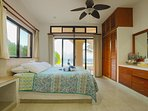 North side lower bedroom w/ king bed. Step right out onto the beach