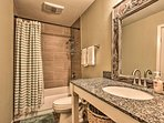 The master en-suite bathroom is equipped with a shower/tub combo.