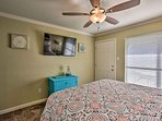The second bedroom is complete with a flat-screen TV and queen bed.