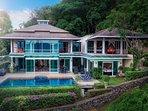 Unique architect designed villa is surrounded by landscaped tropical gardens.