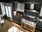 Thermador range, two Miele dishwashers and a Bunn restaurant coffee maker.