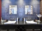 The Ensuite has two sinks, each with lighted vanity mirrors.