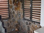 Sunken Stone Shower in East Bedroom