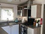 Kuchen with gas oven, microwave, washer/dryer, fridge/freezer