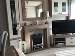 Lounge with remote controlled electric fire