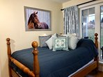 Country blue double bedroom with quality bedding and incredible natural sunlight.